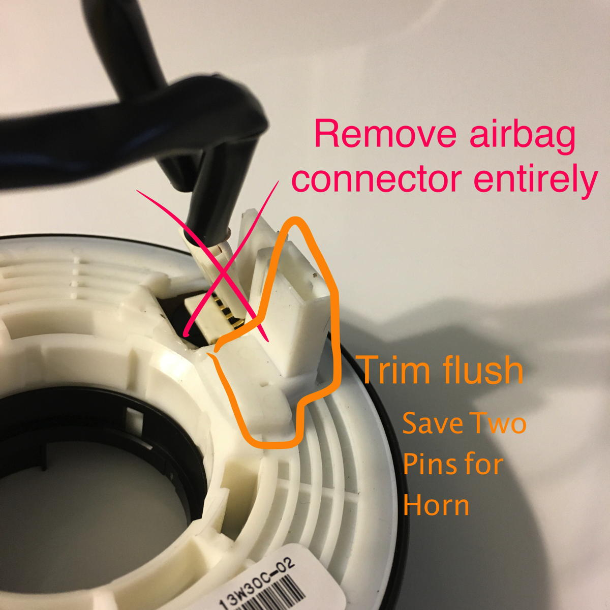 The slip-ring has a tab that fits into a slot at the bottom of the stock steering wheel at the six-o'clock position. This positions the tab at the center of ...